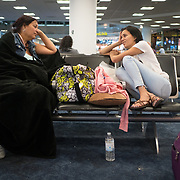 SEPTEMBER 23 - MIAMI, FLORIDA - <br /> Nicole Castro, 25, right and her mother Beth Castro, 53,  Puerto Ricans living in Killeen, TX, waits in an American Airlines gate at Miami International Airport after her 7:20AM flight to Puerto Rico was cancelled. The Castro family is trying to get to the island to visit family affected by the destructive path of Hurricane Maria.<br /> (Photo by Angel Valentin for NPR)