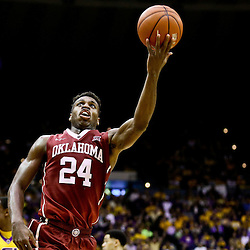 Jan 30, 2016; Baton Rouge, LA, USA; Oklahoma Sooners guard Buddy Hield (24) shoots against the LSU Tigers during the second half of a game at the Pete Maravich Assembly Center. Oklahoma defeated LSU 77-75. Mandatory Credit: Derick E. Hingle-USA TODAY Sports