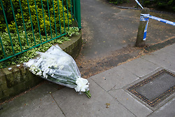 © Licensed to London News Pictures. 02/04/2019. London, UK. Flowers by a member of public left on Grafton Road, junction with Vicars Road in Kentish Town, north west London where a man in his 20s was found stabbed around 8.30pm on Monday 1 April 2019. He was pronounced dead at the scene. Photo credit: Dinendra Haria/LNP