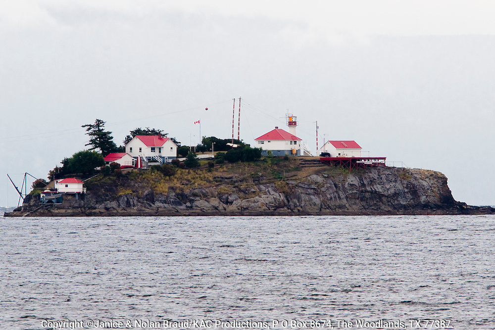 Chrome Island Lighthouse just off the southern point of Denman Island, a Gulf Island off the coast of Vancouver Island. Active light, built in 1891. Original light was replaced in 1922. Located on a small island just off Boyle Point near the community of Deep Bay. Staffed by Canadian Coast Guard.