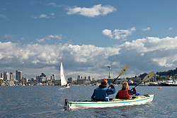 North America, United States, Washington, Seattle, couple kayaking on Lake Union near Space Needle and downtown Seattle