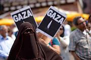 Frankfurt am Main | 26 July 2014<br /> <br /> Am Samstag (26.07.2014) demonstrierten etwa 500 Menschen auf dem R&ouml;merberg in Frankfurt am Main f&uuml;r Frieden in Pal&auml;stina / Gaza und f&uuml;r ein sofortiges Ende der israelischen Milit&auml;reins&auml;tze dort.<br /> Hier: Vor kleinen Plakaten mit der Aufschrift &quot;Gaza&quot; und einer brennenden Kerze steht eine vollkommen verschleierte Frau.<br /> <br /> &copy;peter-juelich.com<br /> <br /> FOTO HONORARPFLICHTIG!<br /> <br /> [No Model Release | No Property Release]