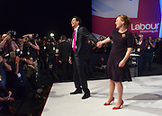 © Licensed to London News Pictures. 02/10/2012. Manchester, UK Ed Miliband kisses his wife Justine, Labour Party leader finishes making his leaders speech on Day 3 at The Labour Party Conference at Manchester Central today 2nd october 2012. Photo credit : Stephen Simpson/LNP