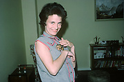 A sixties portrait of a mother holding the family pet hamster, on 13th July, in North Rhine-Westphalia, Germany.