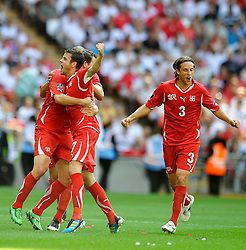 04.06.2011, Wembley Stadium, London, ENG, UEFA EURO 2012, Qualifikation, England vs Switzerland, im Bild Tranquillo Barnetta (C) of Switzerland celebrates his first  goal..England v Switzerland.Euro 2012 qualifying.Wembley Stadium. London. UK. 4/6/11. EXPA Pictures © 2011, PhotoCredit: EXPA/ IPS/ Sean Ryan +++++ ATTENTION - OUT OF ENGLAND/UK and FRANCE/FR +++++
