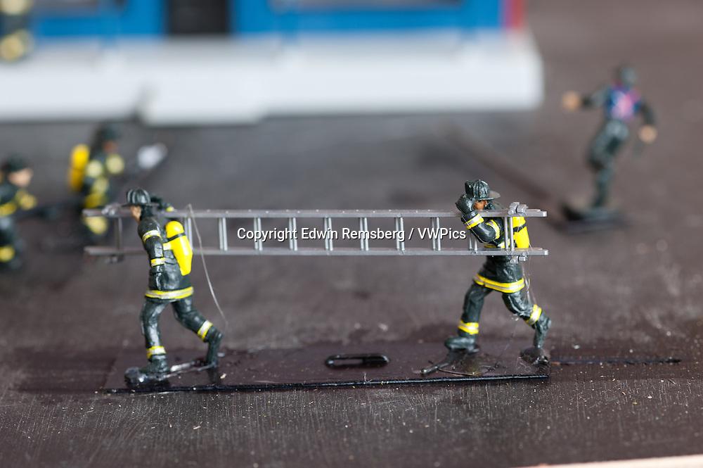Miniature firefighters of a train garden