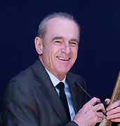 Francis Rossi of Status Quo <br /> At Bonham's, London, Great Britain <br /> 12th November 2019 <br /> During a review of Bonhams Entertainment Memorabilia Sale featuring his famous green Fender Telecaster guitar <br /> Francis Rossi and his green Fender Telecaster guitar, estimate £100,000 – 150,000<br /> <br /> <br /> Francis' green Fender Telecaster– one of rock music's most recognised guitars – is the star lot in the Entertainment Memorabilia Sale taking place on Tuesday 17 December at Bonhams Knightsbridge, with an estimate of £100,000 - £150,000. <br /> <br /> Purchased second-hand in Glasgow by Rossi in 1968 for £75, and in the musician's ownership for more than 50 years, Francis' Fender has been an integral part of Status Quo's history, from being played on 'Down the Dustpipe' in 1970, and then on virtually every one of the band's singles and albums up to 2015. <br /> <br /> The guitar also featured in the majority of the band's 6,000 live shows before being retired by Francis in 2015, notably appearing in arguably the band's most high-profile performance, the globally aired 'Live Aid' concert at London'sWembley Stadium in 1985, which had a total audience of 1.9 billion.<br />  <br /> Photograph by Elliott Franks