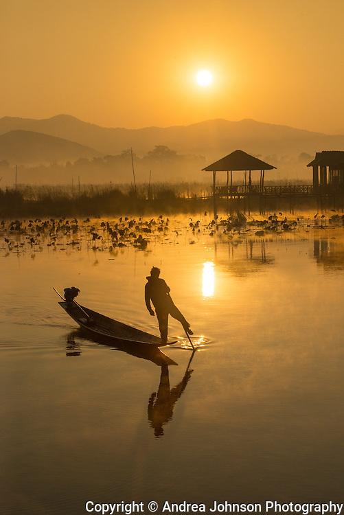 Famous one legged paddling fisherman on Inle Lake at sunrise, Inle Lake, Burma (Myanmar).