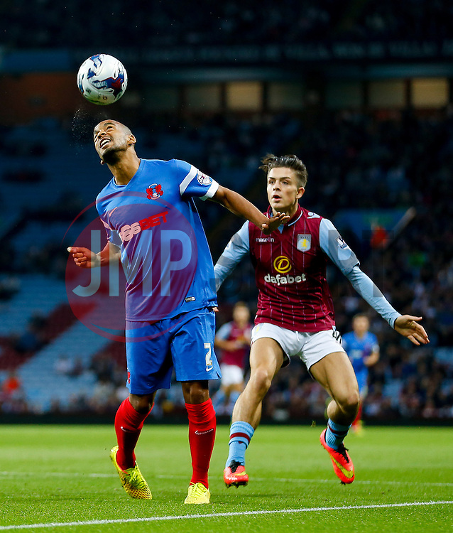 Elliot Omozusi of Leyton Orient is challenged by Jack Grealish of Aston Villa - Photo mandatory by-line: Rogan Thomson/JMP - 07966 386802 - 27/08/2014 - SPORT - FOOTBALL - Villa Park, Birmingham - Aston Villa v Leyton Orient - Capital One Cup Round 2.