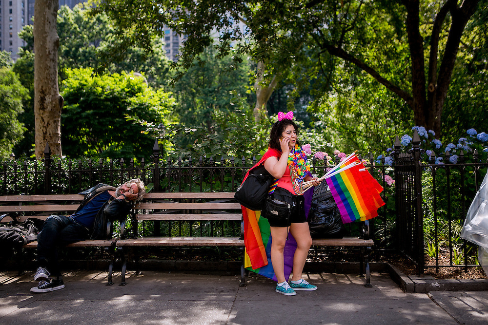 NEW YORK, NY - JUNE 26, 2016: Miriam Aquino sells flags at Madison Square Park in advance of the annual Pride parade in New York, New York. CREDIT: Sam Hodgson for The New York Times.