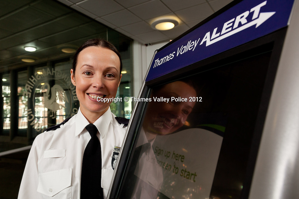 Inspector Emma Garside of Thames Valley Police with the Thames Valley Alert Kiosk, which is being used to promote sign up to the crime and safety messages delivery service. The kiosk is touring throughout the TVP region, in particular at Universities, Colleges and Local Government offices. Aylesbury, UNITED KINGDOM. October 09 2012. <br /> Photo Credit: MDOC/Thames Valley Police<br /> &copy; Thames Valley Police 2012. All Rights Reserved. See instructions.