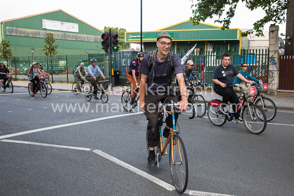 London, UK. 18 July, 2019. Climate activists from Extinction Rebellion arrive on bicycles to protest at Heathrow's 'masterplan' consultation event in Lambeth against plans for a third runway at Heathrow airport and to highlight Heathrow airport's major contribution to climate change.