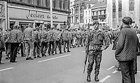 A soldier keeps a watchful eye on a UDA show-of-strength parade in the city centre, Belfast, N Ireland, 16th September 1972. 197209160566a<br />