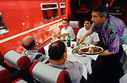 Disentis, passengers having lunch at the panoramic car of Glacier Express.