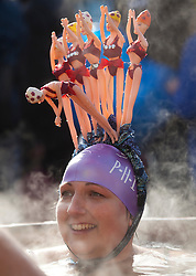 © Licensed to London News Pictures. 24/01/2015. London, UK. Contestant Ella Foote enjoys the sauna after braving cold temperatures at the 6th UK Cold Water Swimming Championships at Tooting Bec Lido, south London. Over, 650 swimmers will take the plunge to compete in a variety of chilly races.  Photo credit : Isabel Infantes / LNP