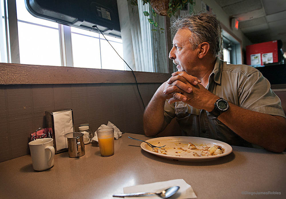"About to finish his breakfast in a Florida diner by the side of a highway, Joe pauses to reflect on his long trucking career. ""When I got started it was a respectable job, you had honor,"" Joe said quietly while staring at the highway. ""I don't care anymore, fuel is so high I am going to shut my truck down until something happens. Let them find a rookie to do what I do."""