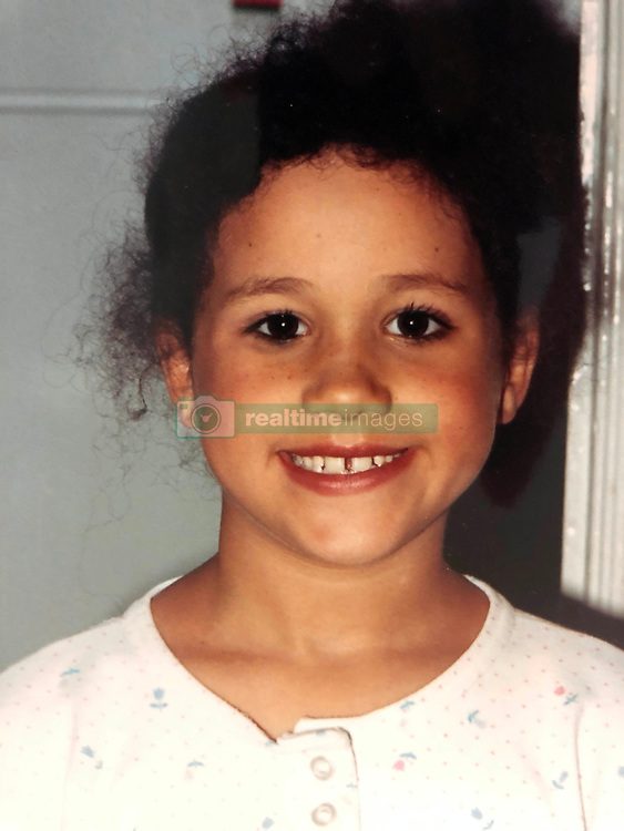 """*PREMIUM EXCLUSIVE RATES. NO WEB UNTIL 18.45 BST MAY 15* Here's royal bride-to-be Meghan Markle as the world has never seen her before. An incredible collection of 60 exclusive photographs offer a fascinating insight into the modest and ordinary childhood of the American woman who has captured the heart of Prince Harry. In one hilarious snap, Meghan, aged just five, is seen donning a crown as she imitates The Queen at a birthday party in Los Angeles. In another photo she is seen dressing up for Halloween as horror TV hostess Elvira complete with a black wig and dress while only seven-years-old. At the age of six she is seen posing with Mickey Mouse and other cartoon characters at Disneyland in Anaheim, CA. Other photos show a teenage Meghan cuddling her father Thomas who will walk the 36-year-old actress down the aisle in a lavish ceremony at Windsor Castle. The photographs underline how Meghan's life growing up with her mother Doria Ragland at the small two-bedroom, two-bathroom LA apartment is a far cry from the majesty and wealth of Britain's Royal Family which will become her new life. A childhood friend said: """"Meghan had the most normal upbringing you could imagine – but we always knew she was destined for great things. """"Now she is set to live every girl's dream and become a princess by marrying Prince Harry. """"I am absolutely blown away that the ordinary little girl we knew growing up in a regular apartment in Southern California is going to be married to a member of the British Royal Family."""" The friend recalled that curly-haired Meghan was just like any other kid growing up in the Mid-Wilshire area of LA and had friends from all races and background. """"I think when she was growing up and around other kids she identified herself as African American,"""" said the friend. """"Being bi-racial was never an issue for her. She didn't know any difference and it was never a big thing for her. """"I think it perhaps became more of an issue for her whe"""