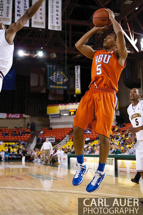 November 25th, 2010:  Anchorage, Alaska - Houston Baptist guard, Miles Dixon (5) pulls up for a jump shot in the Huskies 55-73 loss to Arizona State in a first round game of the Great Alaska Shootout.