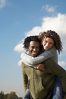 Man giving woman piggyback
