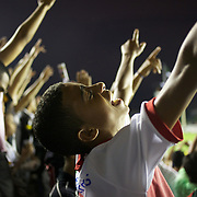 A young Vasco fan celebrates after his side had taken the leader with a goal from Vasco striker Eder Luis during the Vasco V Atletico MG  Brasileiro  league match as São Januário Stadium. The match ended in a 1-1 draw, Rio de Janeiro, Brazil. 9th September 2010. Photo Tim Clayton.