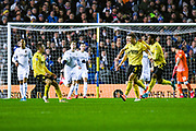 Millwall defender Shaun Hutchinson (4) scores a goal and celebrates to make the score 0-1 during the EFL Sky Bet Championship match between Leeds United and Millwall at Elland Road, Leeds, England on 28 January 2020.