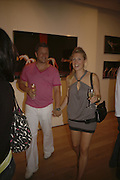 ROCK GALPIN AND HOLLY RESTIEAUX, Missoni Sport private view - exhibition of photos by Lucy Missoni. The Leonard Street Gallery, London, EC2, 20 July 2006. ONE TIME USE ONLY - DO NOT ARCHIVE  © Copyright Photograph by Dafydd Jones 66 Stockwell Park Rd. London SW9 0DA Tel 020 7733 0108 www.dafjones.com