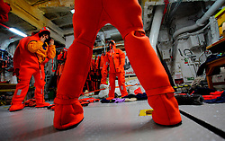 ATLANTIC OCEAN ABOARD ARCTIC SUNRISE 21MAY11 -  Greenpeace activists wear survival suits prior to swim training in the north Atlantic.<br /><br /> <br /> <br /> <br /> Photo by Jiri Rezac / Greenpeace