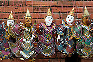 Chiang Mai Sunday Market Thai Puppets - The Sunday Market, sometimes called the weekend market takes place in the Tapae Gate area and stretches into the middle of the old city where can find traditional Thai clothing, silk and local crafts at this bustling market.