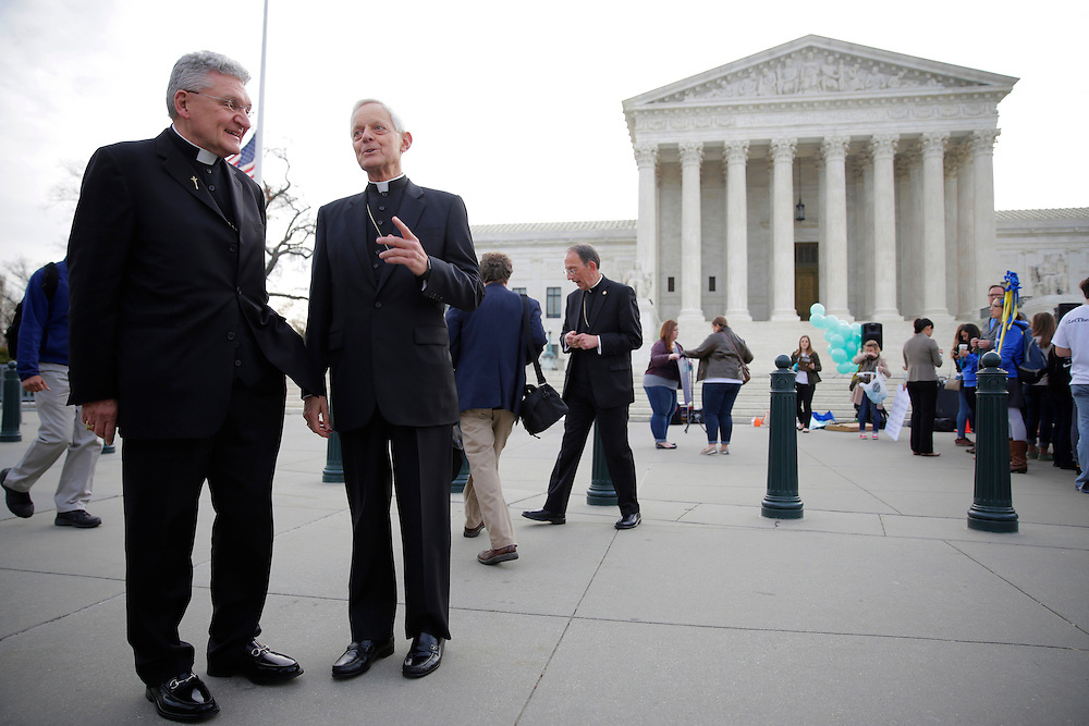 Bishop David Zubik (L) of Pittsburgh and Cardinal Donald Wuerl of Washington speak before before Zubik v. Burwell, an appeal brought by Christian groups demanding full exemption from the requirement to provide insurance covering contraception under the Affordable Care Act, is heard by the U.S. Supreme Court in Washington March 23, 2016.      REUTERS/Joshua Roberts