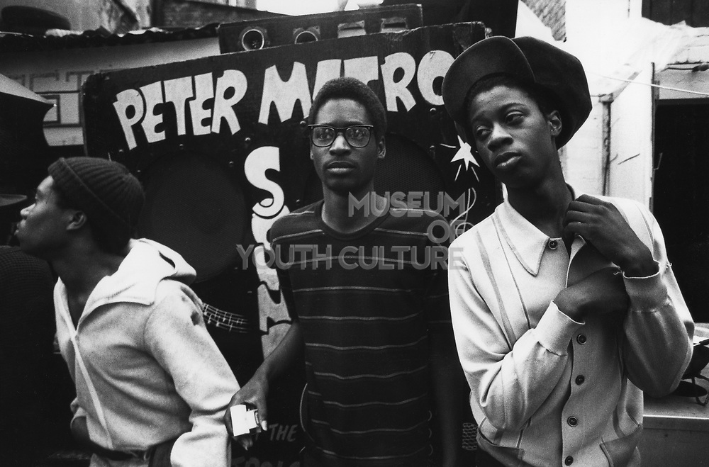 A group of men stood in front of a sound system, Notting Hill Carnival, London, UK 1983.