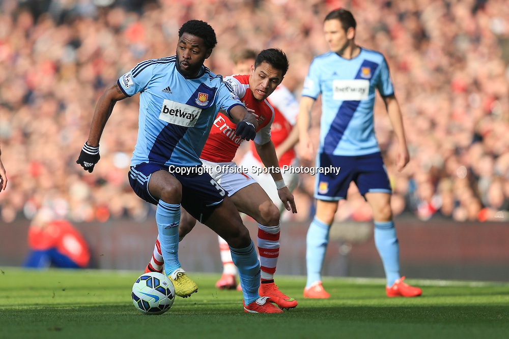 14 March 2015 - Barclays Premier League - Arsenal v West Ham - Alex Song of West Ham in action with Alexis Sanchez of Arsenal - Photo: Marc Atkins / Offside.