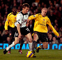 Photo: Ed Godden.<br /> Fulham v Arsenal. The Barclays Premiership. 29/11/2006.<br /> Fulham's Brian McBride (L) is tackled by Philippe Senderos.