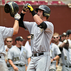 June 04, 2011; Tallahassee, FL, USA; UCF Knights first baseman Jonathan Griffin (33) celebrates with teammate Derek Luciano (4) after hitting a two run homerun during the sixth inning of the Tallahassee regional of the 2011 NCAA baseball tournament against the Bethune-Cookman Wildcats at Dick Howser Stadium. Mandatory Credit: Derick E. Hingle
