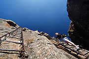 Walkers use the chain ladders to climb to the top of the Amphitheatre in the Drakensberg mountains. Royal Natal National Park. Kwa-Zulu Natal, South Africa..© Zute Lightfoot.Zute & Demelza Lightfoot.www.lightfootphoto.com