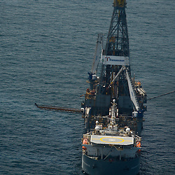 The Transocean Discoverer Enterprise drill ship remains idle as test continue on the cap placed at the BP Plc MC252 well site in the Gulf of Mexico off the coast of Louisiana, U.S., on Sunday, July 18, 2010. BP Plc said that a pressure test on its damaged Macondo well halted the flow of oil into the Gulf for the first time in three months. The oil spill, the biggest in U.S. history, had been spewing 35,000 to 60,000 barrels of oil a day since the drilling rig exploded on April 20. Photographer: Derick E. Hingle/Bloomberg