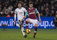 Football - 2016 / 2017 Premier League - West Ham United vs. Manchester United<br /> <br /> Havard Nordtveit of West Ham being closed down by Jesse Lingard of Manchester United at The London Stadium.<br /> <br /> COLORSPORT/DANIEL BEARHAM