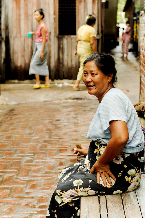 Woman sitting at a Mandalay alley