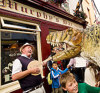 This week at the Galwya Arts Festival the eye-popping visual feast that is the Dinosaur Petting Zoo is an extraordinary performance throught the streets of Galway where he met this busker and his cardboard Banjo! Children will got up close and personal with these amazingly life-like creatures during this fun-filled show. Photo:Andrew Downes