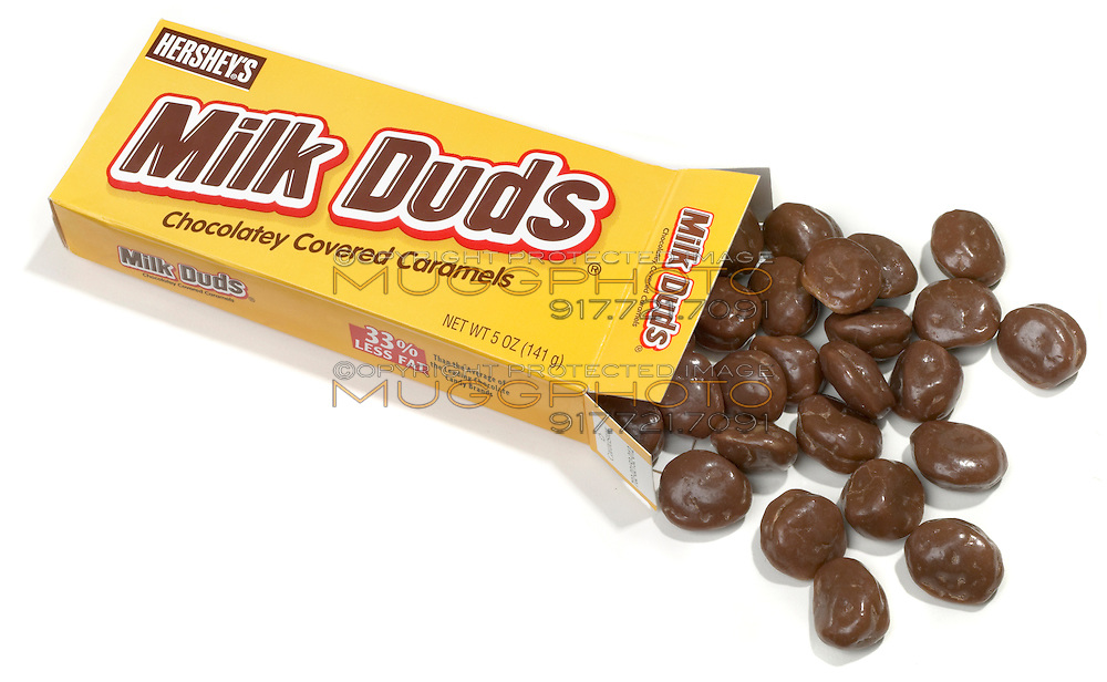 spilliing milk duds photographed on a white background