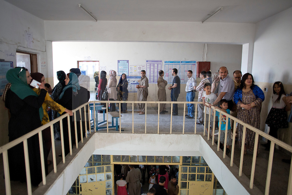 © Licensed to London News Pictures. 30/04/2014. Sulaimaniya, Iraq. Iraqi-Kurdish people wait to cast their votes in a school being used as a polling station during the 2014 Iraqi parliamentary elections in Sulaimaniya, Iraqi-Kurdistan today (30/04/2014). <br /> <br /> The period leading up to the elections, the fourth held since the 2003 coalition forces invasion, has already seen polling stations in central Iraq hit by suicide bombers causing at least 27 deaths. Photo credit: Matt Cetti-Roberts/LNP