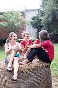 Kristen Wofford, Sawyer Barcus, and Hally Barcus enjoy Saturdays in Saxapahaw.