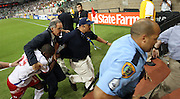 09 JUL 2009:  Panama's Ricardo Phillips  is rushed off the field after being ejected during a soccer game between Mexico and Panama July 09, 2009 at Reliant Stadium in Houston, Texas.