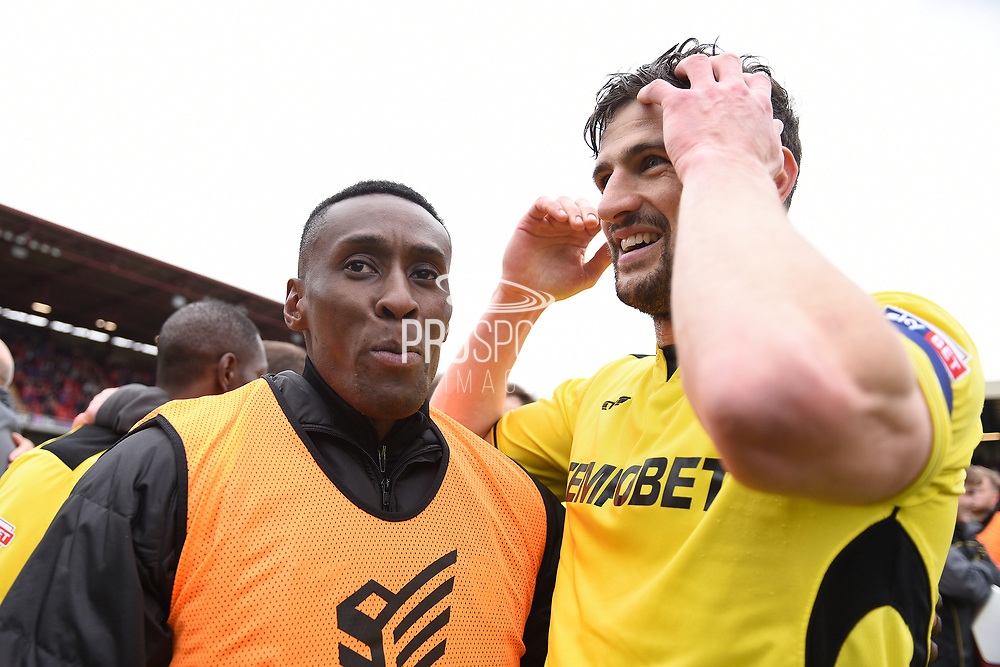 Burton Albion midfielder Lloyd Dyer (11) and captain Burton Albion defender John Mousinho (4)celebrate Burton Albion staying in the Championship in only their first season in the second tier during the EFL Sky Bet Championship match between Barnsley and Burton Albion at Oakwell, Barnsley, England on 29 April 2017. Photo by Richard Holmes.