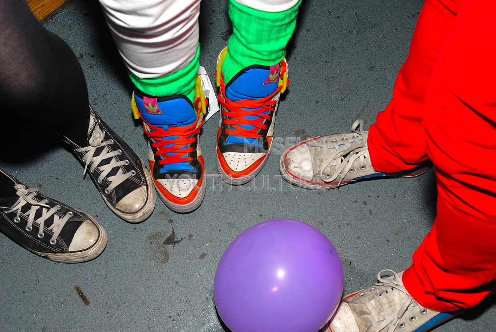 3 pairs of trainers, one accessorised with day-glo laces and leggins, Klaxons gig, February 2007