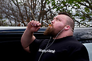 Eddie Hall aka &quot;The Beast&quot; - The Strongest Man in the World.<br /> A feature following what it takes to be Eddie Hall, who has become the first Brit to win World's Strongest Man competition in 24 years. <br /> Caption: Eddie takes a breath on an electric cigaret before competing at the European Strongest Man competition.<br /> Photographer: Rick Findler / Story Picture Agency