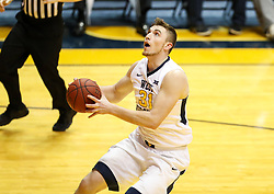 Dec 16, 2017; Morgantown, WV, USA; West Virginia Mountaineers forward Logan Routt (31) shoots in the lane during the first half against the Wheeling Jesuit Cardinals at WVU Coliseum. Mandatory Credit: Ben Queen-USA TODAY Sports