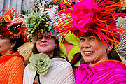 New York, NY - April 16, 2017. Women from The City Chicks decked out in hats designed by Jodie Trapani, with wraps designed by Alexandra Tsoukala, at New York's annual Easter Bonnet Parade and Festival on Fifth Avenue.