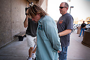 21 SEPTEMBER 2010 - PHOENIX, AZ:  Det. Darren Emfinger (CQ) leads Ty Leonard (CQ BY PHOENIX PD) into Phoenix police headquaters. Leonard is a suspect in child molestation cases. Crime has steadily dropped in Phoenix over the past few years, in line with national trends. The latest number released this month showed Phoenix reported fewer 2010 homicides, rapes, robberies, thefts - in addition to other major crimes -- compared with the same time period the previous year. Detectives in the Phoenix police department's Major Offender Unit make several arrests every day.   PHOTO BY JACK KURTZ