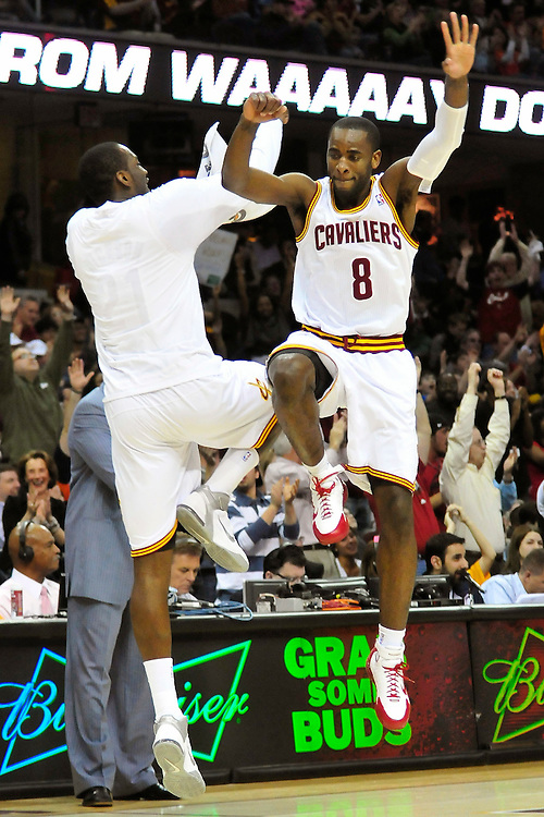 April 13, 2011; Cleveland, OH, USA; Cleveland Cavaliers guard Christian Eyenga (8) and power forward J.J. Hickson (21) leap into the air in celebration after Eyenga hit a three point shot during the final minutes of the fourth quarter against the Washington Wizards at Quicken Loans Arena. The Cavaliers beat the Wizards 100-93. Mandatory Credit: Jason Miller-US PRESSWIRE
