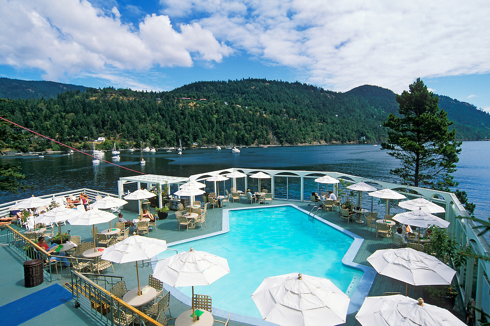 Rosario Resort swimming pool area overlooking Cascade Bay on Orcas Island; San Juan Islands, Washington.
